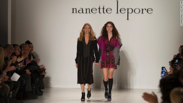 Nanette Lepore walks down the runway with her daughter, Violet, after showing her fall collection.