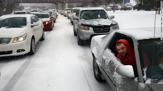 Kevin Miller looks out of the passenger window of his friend's car as they sit stuck in traffic during a winter storm in Raleigh, North Carolina, on Wednesday, February 12.