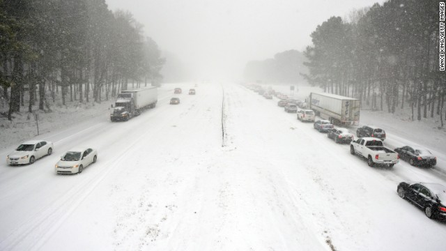 Traffic moves slowly along Wade Avenue in Raleigh on February 12. Motorists were encouraged to stay off roads.