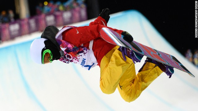 Chinese snowboarder Li Shuang holds her board during the women's halfpipe finals on February 12.