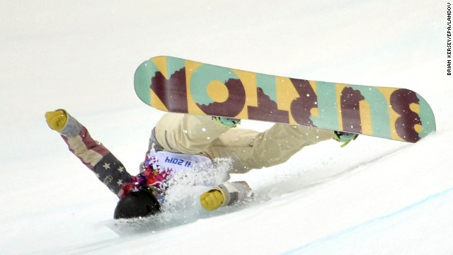 Kelly Clark of the United States falls during her first run in the women's halfpipe finals February 12.