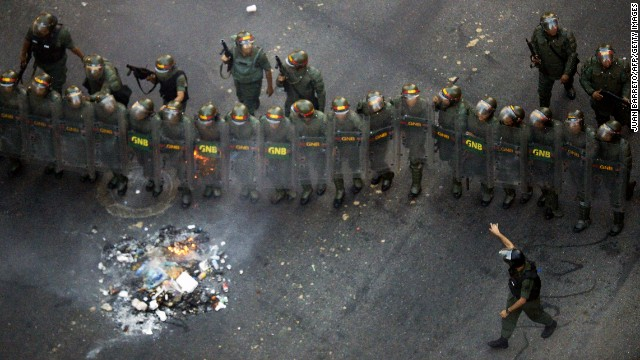 Members of the Venezuelan National Guard take their positions during an opposition demo.