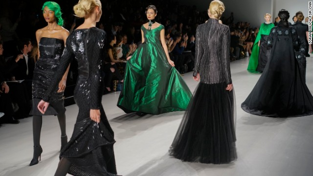Later in the show, he upped the flashy factor by incorporating Kelly green into gowns, bowties and even updos.