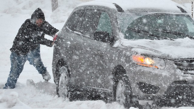 A man in Bethlehem helps push a stranded motorist February 13.
