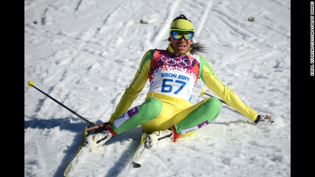 Cross-country skier Mathilde Amivi Petitjean of Togo sits in the snow after crossing the finish line in the women's 10-kilometer classic on February 13.