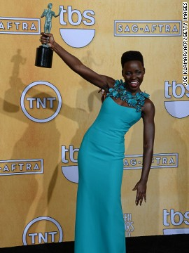 Nyong'o posing after her win at the annual Screen Actors Guild Awards as Best Female Actor in a Supporting Role award on January 18.
