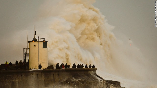 FEBRUARY 13 - PORTHCAWL HARBOUR, UK: Waves break over the coast as western Europe continues to be battered by high winds and heavy rain. Britain's weather service says it sees the tentacles of climate change in a spate of storms and floods battering the country.