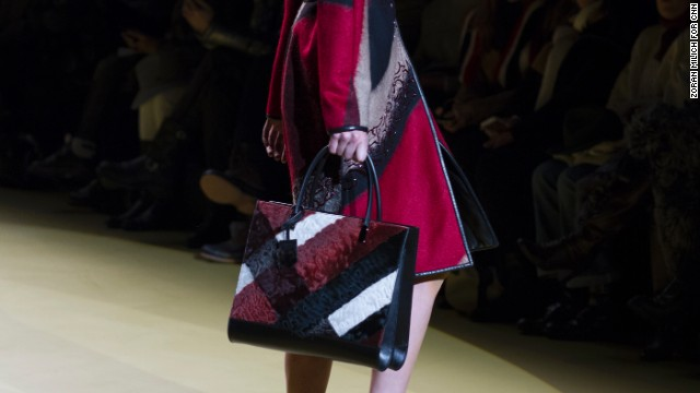 J. Mendel complemented this fall ensemble with a red, black and white color-blocked tote.