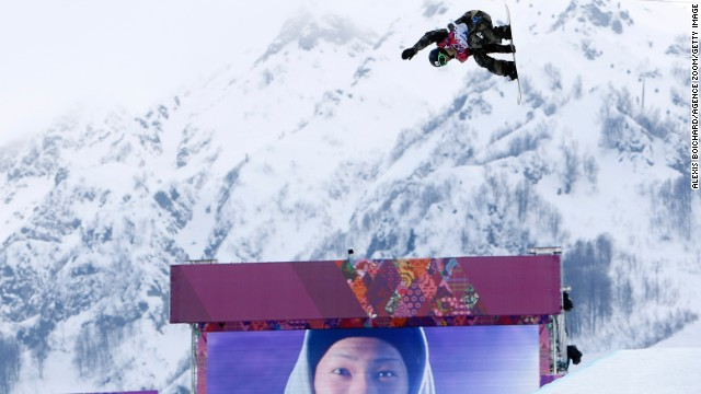 The cool image of snowboarding is reinforced by big screens showing the competitors posing for cameras. Here, Taku Hiraoka of Japan competes during the halfpipe event.