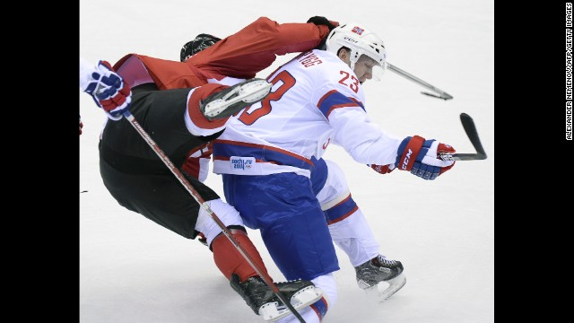 Norway's Mats Trygg collides with Canada's Sidney Crosby during a men's hockey game on February 13.