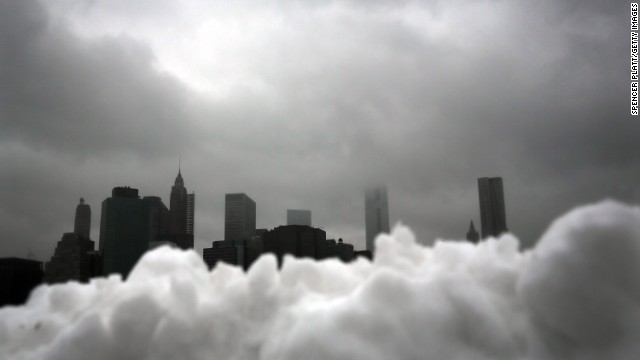 The lower Manhattan skyline seen behind a pile of snow in Brooklyn on February 13.