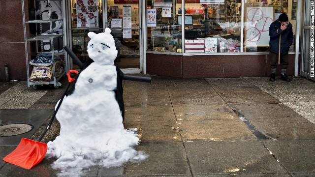 A snowman is seen in front of a hardware store in Washington on February 13.
