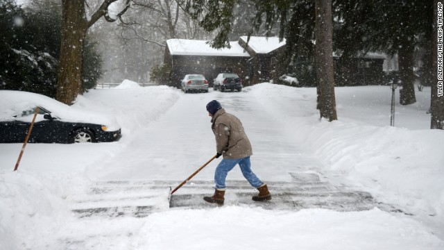 Don Hammond of Newtown shovels his driveway as snow continues to fall in Connecticut on February 13.