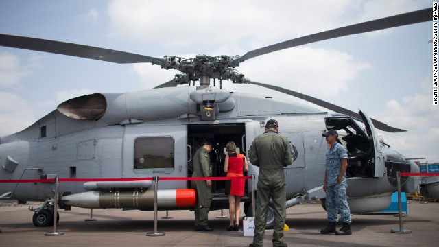 A woman is shown a Seahawk S-70B helicopter, manufactured by Sikorsky Aircraft Corp., on February 12.