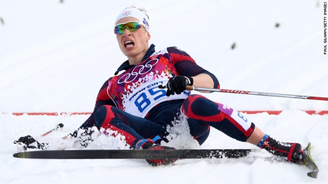 Saevar Birgisson of Iceland collapses after competing in the men's 15-kilometer classic.