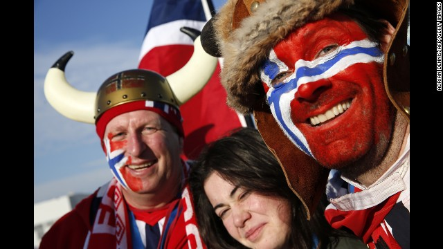 Norwegian visitors pose for a photo at the Olympic Park on February 14.