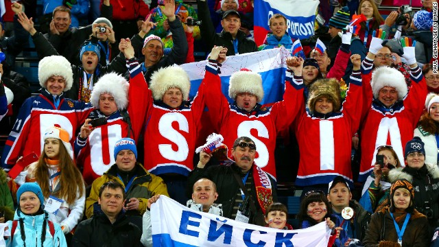Russian fans watch the women's 15-kilometer biathlon on February 14.