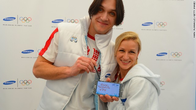 Valentine's Day cards are so last century in Sochi. These days it's all about digital love. Here Russian figure skating gold medalists Maxim Trankov and Tatiana Volosozhar create their very own digital Valentine card.