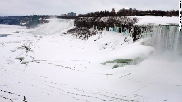 Ice forms on the Niagara River in front of the American Falls on the left and the Canadian Horseshoe Falls on the right on Wednesday, February 5.