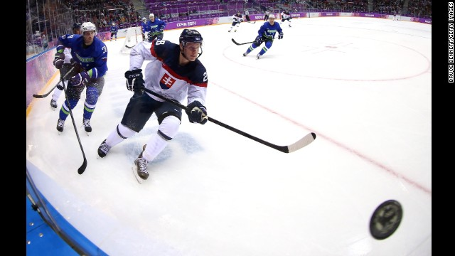 Richard Panik of Slovakia and Ales Kranjc of Slovenia chase after a puck during their game February 15.