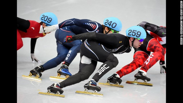 American Chris Creveling, center, competes during a men's 1,000-meter short track speedskating race on February 15.