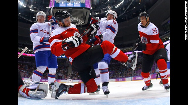 Thomas Pock of Austria falls to the ice in front of the net during the men's hockey game against Norway on February 16.