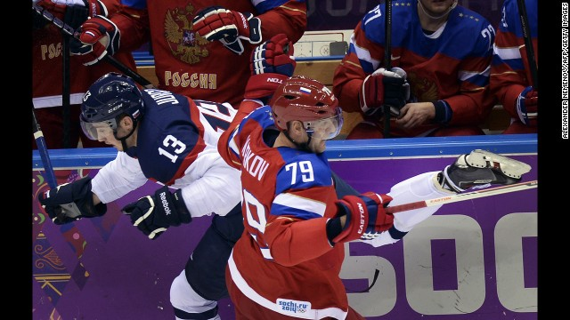 Russia's Andrei Markov challenges Slovakia's Tomas Jurco during the men's ice hockey game on February 16.