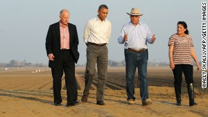President Barack Obama (2nd-L) walks with California Governor Jerry Brown (L), Joe and Maria Del Bosque (R) of Empresas Del Bosque farm, addressing California\'s drought situation Friday, Feburary 14, 2014 in Los Banos, CA.