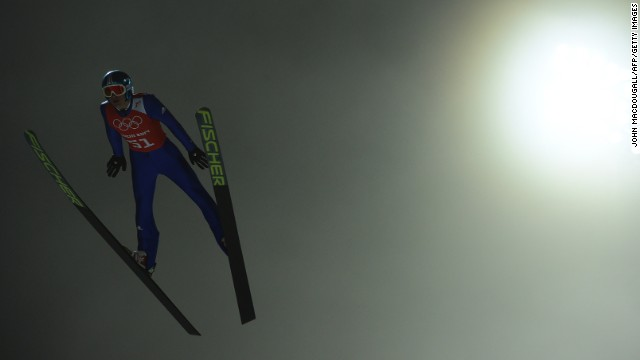 Germany's Richard Freitag jumps in the fog while training for the men's large hill ski jumping event.
