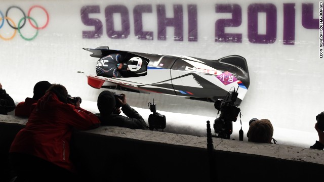 Cory Butner steers an American bobsled with Chris Fogt along for the ride on February 16.