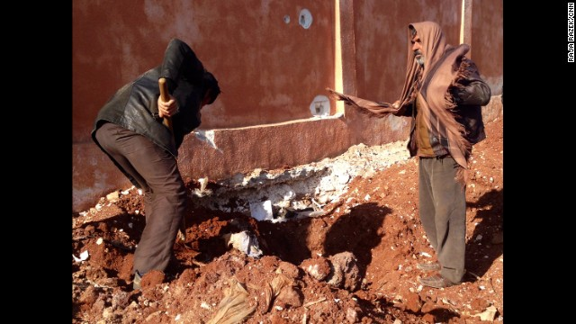 Residents dig up the mass grave behind the jail in an effort to identify those killed and to bury them properly.