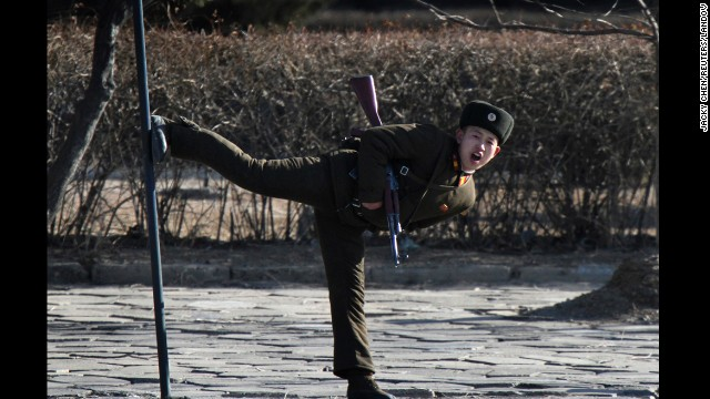 A North Korean soldier kicks a pole along the banks of the Yalu River on Tuesday, February 4.