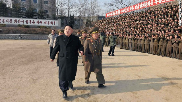 Kim inspects the command of an army unit in this undated photo released Sunday, January 12, by the North Korean Central News Agency (KNCA).