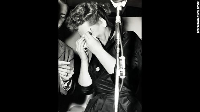 "Judy Holliday bursts into tears in 1951 after winning the best actress Oscar for her performance in ""Born Yesterday."""
