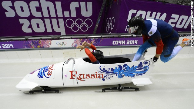 Russian bobsledders Alexander Kasjanov and Maxim Belugin start a run during the two-man competition on February 17.