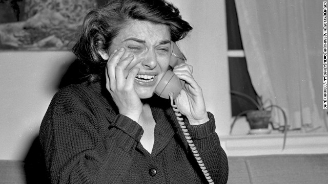 "Anne Bancroft cries in her New York apartment as she accepts a congratulatory phone call following her win for ""The Miracle Worker."""