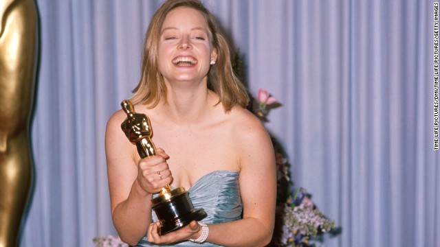 "Jodie Foster holds her Oscar in the press room after winning for her role in ""The Accused."""