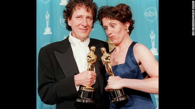 "Frances McDormand, who won best actress for her role in ""Fargo,"" poses with Geoffrey Rush, who won best actor that year."