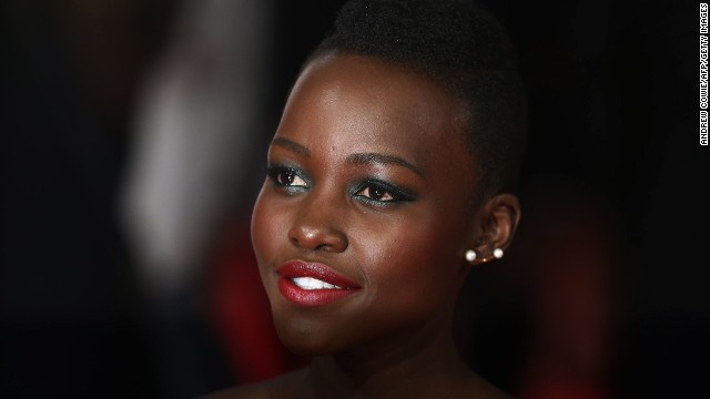 "FEBRUARY 17 - LONDON, UNITED KINGDOM: Kenyan actress<a href='http://cnn.com/2014/02/14/showbiz/1-to-1-lupita-nyongo-life-journey/'> Lupita Nyong'o</a> arrives on the red carpet for the British Academy Film Awards (BAFTA) at the Royal Opera House on February 16. <a href='http://cnn.com/2014/02/14/showbiz/1-to-1-lupita-nyongo-life-journey/'>The 3D space disaster movie ""Gravity"" and the drama ""12 Years a Slave,"" </a>in which Nyong'o performed a supporting role, scooped the awards."