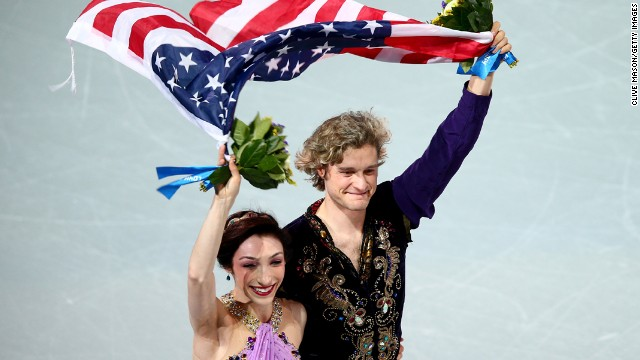 American ice dancers Meryl Davis and Charlie White celebrate winning the Olympic gold medal Monday, February 17, in Sochi, Russia.