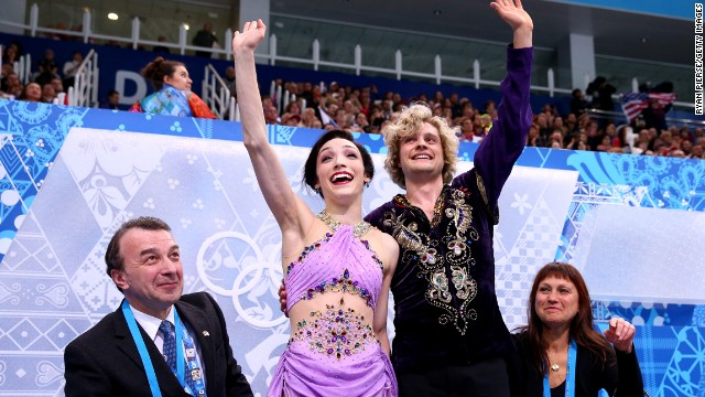 Davis and White wave to fans after the free dance portion of the event.
