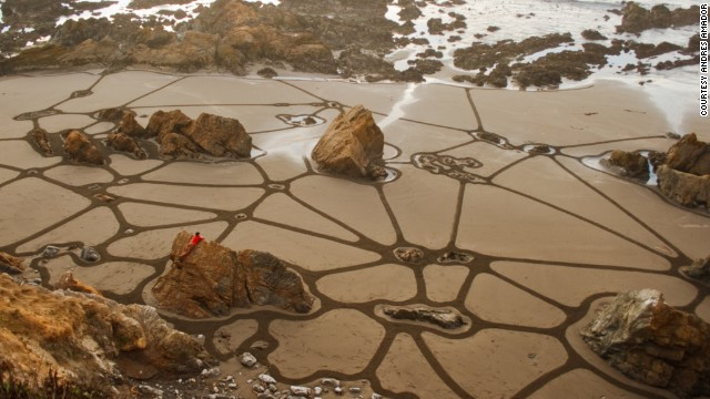 Amador has created hundreds of beach murals, sometimes integrating aspects of the natural landscape in his work.