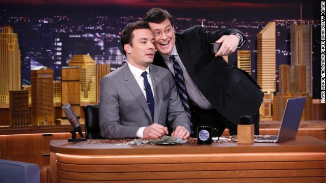 "Jimmy Fallon's takeover of ""The Tonight Show"" has been inevitable, show producer Lorne Michaels told GQ. ""He's the closest to (Johnny) Carson that I've seen of this generation,"" Michaels said. Stephen Colbert joins him to take a selfie on his debut Monday night. Fallon is the latest in a six-decade line of ""Tonight"" hosts."