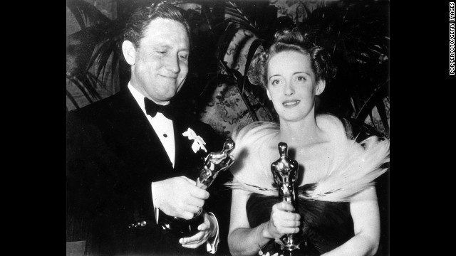 "Spencer Tracy takes home his second best actor Oscar for ""Boys Town."" He appears here with Bette Davis, best actress for ""Jezebel,"" at the ceremony held in 1939."