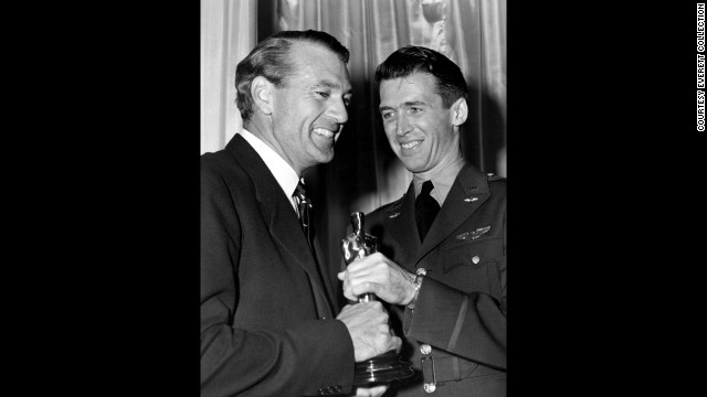 "James Stewart, right, bestows pal Gary Cooper with the statuette for ""Sergeant York."" Cooper nabbed the win over Orson Welles, whose ""Citizen Kane"" also lost out on the best picture award but has become the epitome of a Hollywood classic."