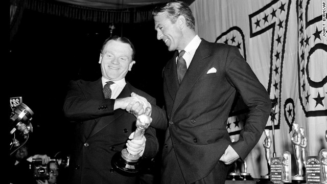 "Gary Cooper, right, congratulates James Cagney for his best actor win in ""Yankee Doodle Dandy"" at the Oscar ceremony held in 1943. Cooper, also a nominee for ""The Pride of the Yankees,"" didn't seem to hold a grudge against Cagney."