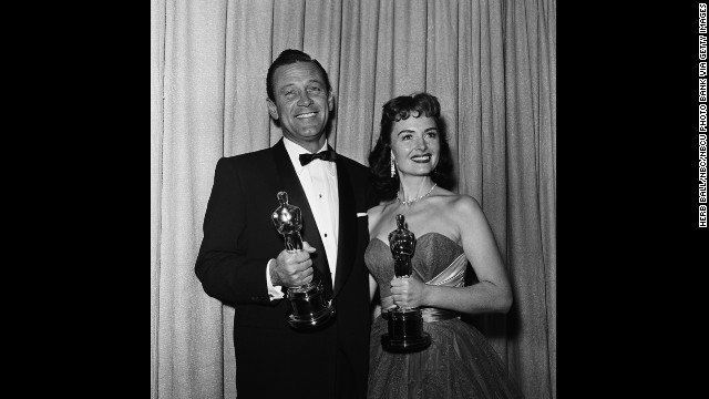 "William Holden celebrates his best actor win for ""Stalag 17"" with best supporting actress winner Donna Reed at the Oscar ceremony in 1954. It was the actor's second nomination; his first was for Billy Wilder's 1950 classic ""Sunset Boulevard."""