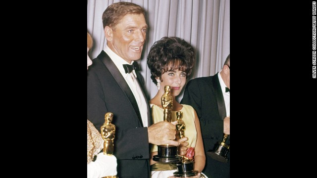 "Burt Lancaster was a winner two times over at the 1961 Oscar ceremony. He won the best actor prize for the title role in ""Elmer Gantry,"" and he had glamorous Elizabeth Taylor, best actress winner for ""Butterfield 8,"" by his side backstage."