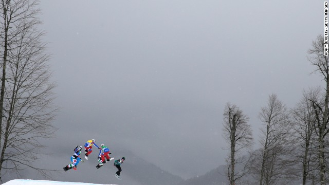 Snowboarders race during a snowboard cross quarterfinal on February 18.