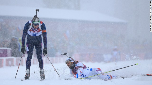 Emil Hegle Svendsen of Norway, left, crosses the line to win gold ahead of Martin Fourcade of France in the men's 15-kilometer mass start biathlon on February 18.